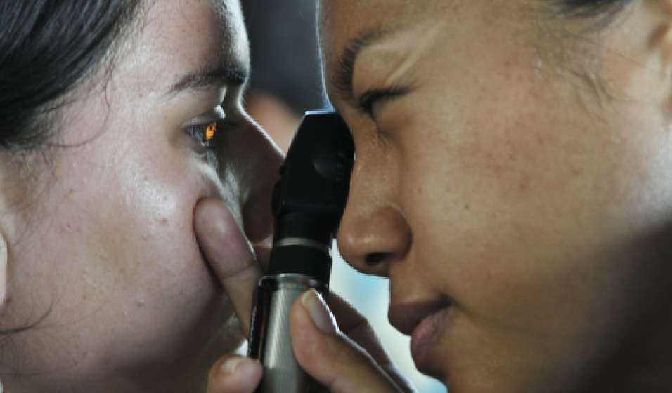 Ophthalmologist examining a patient's eyes